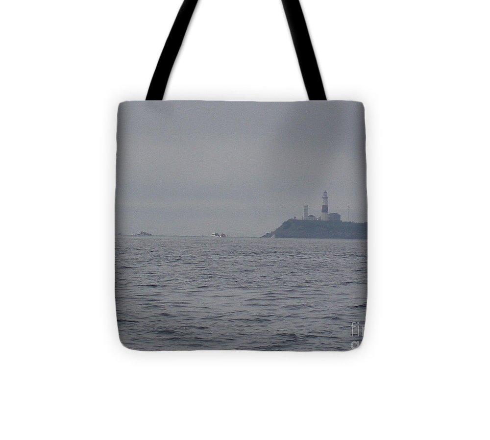 Storm Approaching Montauk Point Tote Bag featuring the photograph Storm Approaching Montauk Point by John Telfer