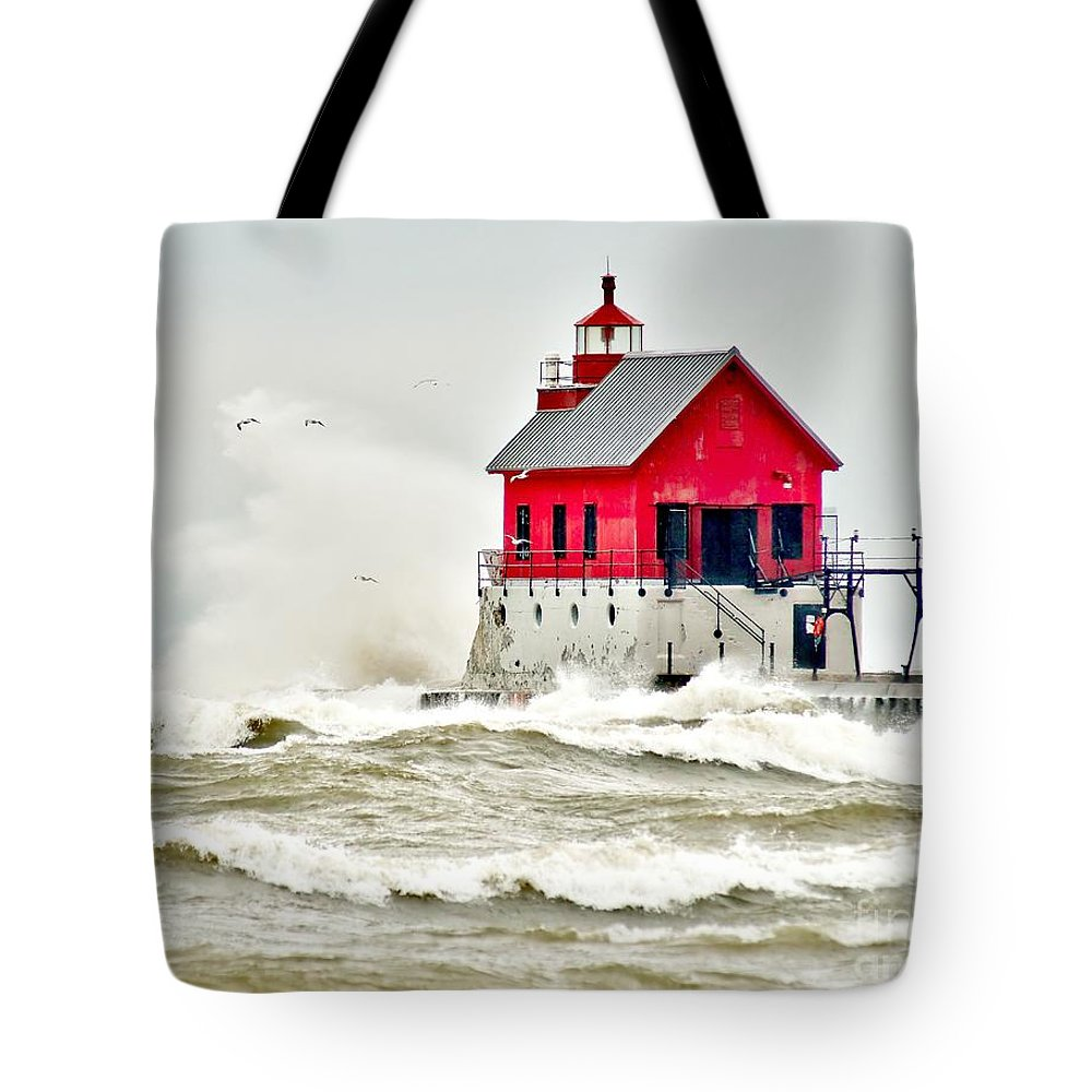 Beach Tote Bag featuring the photograph Stormy At Grand Haven Light by Nick Zelinsky
