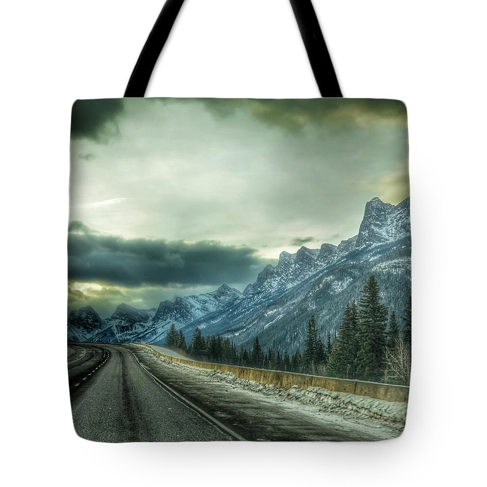 Landscape Tote Bag featuring the photograph Stormy by D White