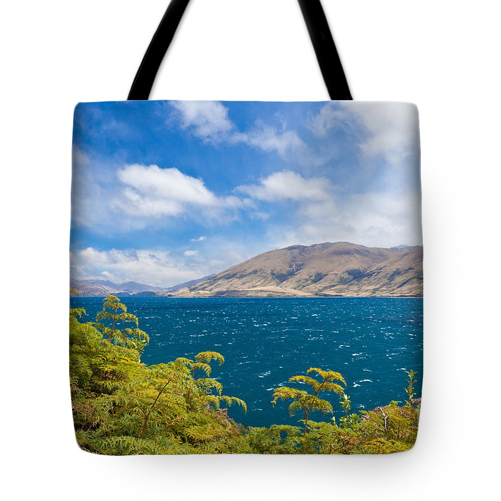 Beautiful Tote Bag featuring the photograph Stormy Surface Of Lake Wanaka In Central Otago On South Island Of New Zealand by Stephan Pietzko