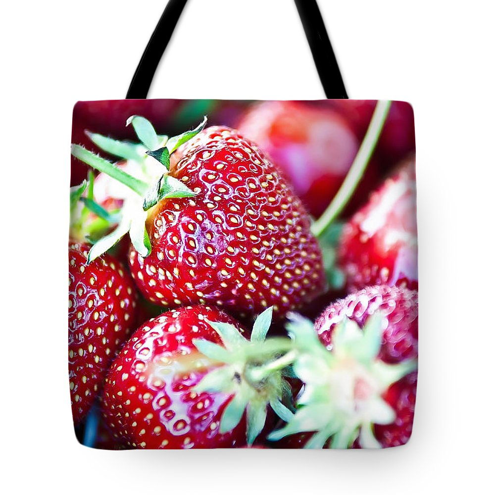 Agriculture Tote Bag featuring the photograph Strawberries by Alex Grichenko