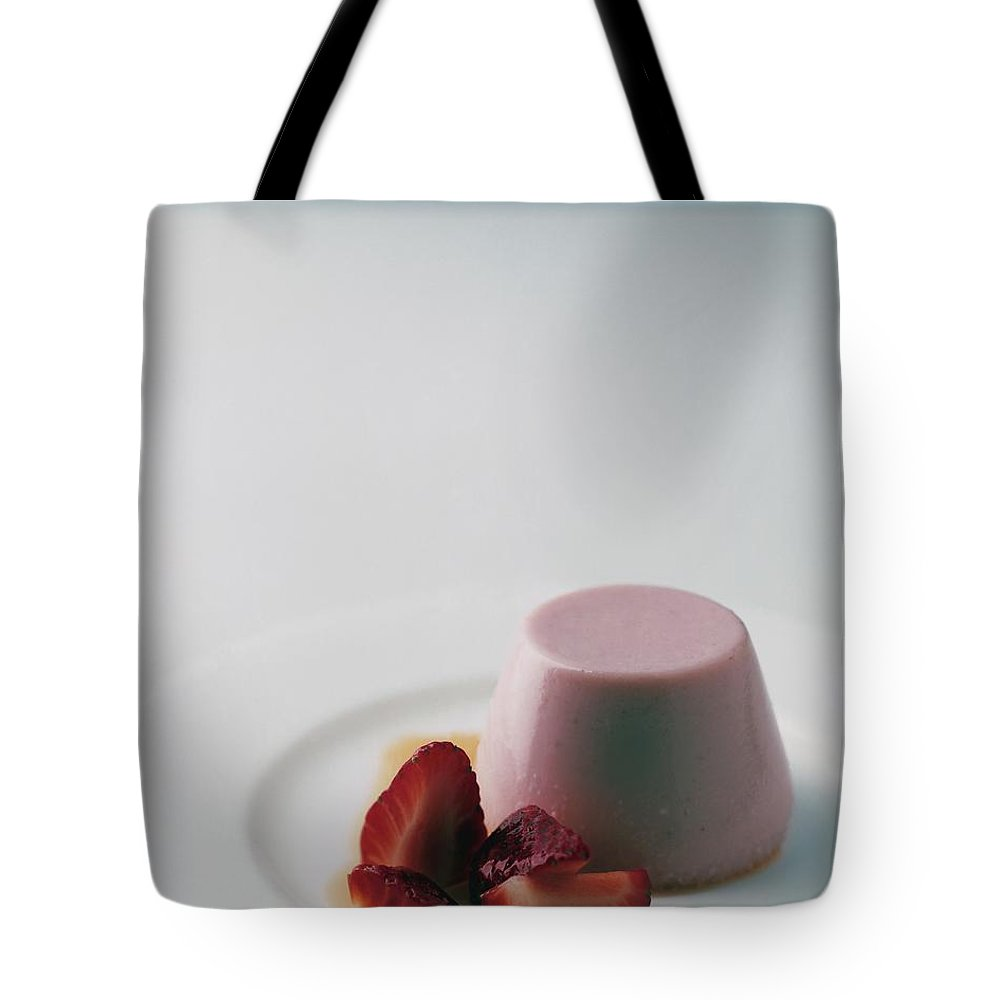 Cooking Tote Bag featuring the photograph Strawberry Panna Cotta With Strawberry Compote by Romulo Yanes