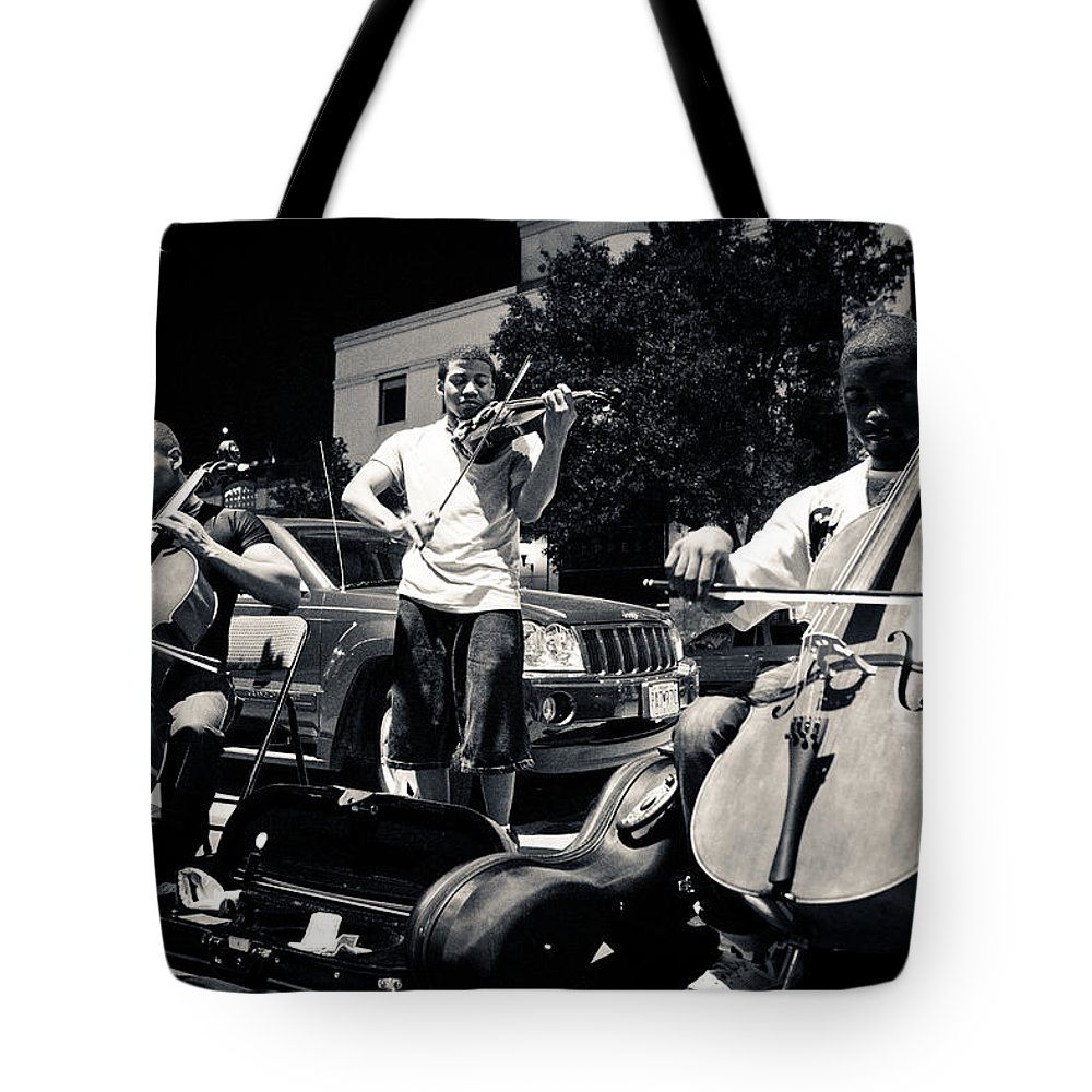 Plaza Street Musicians Tote Bag featuring the photograph Street Musicians by Sennie Pierson