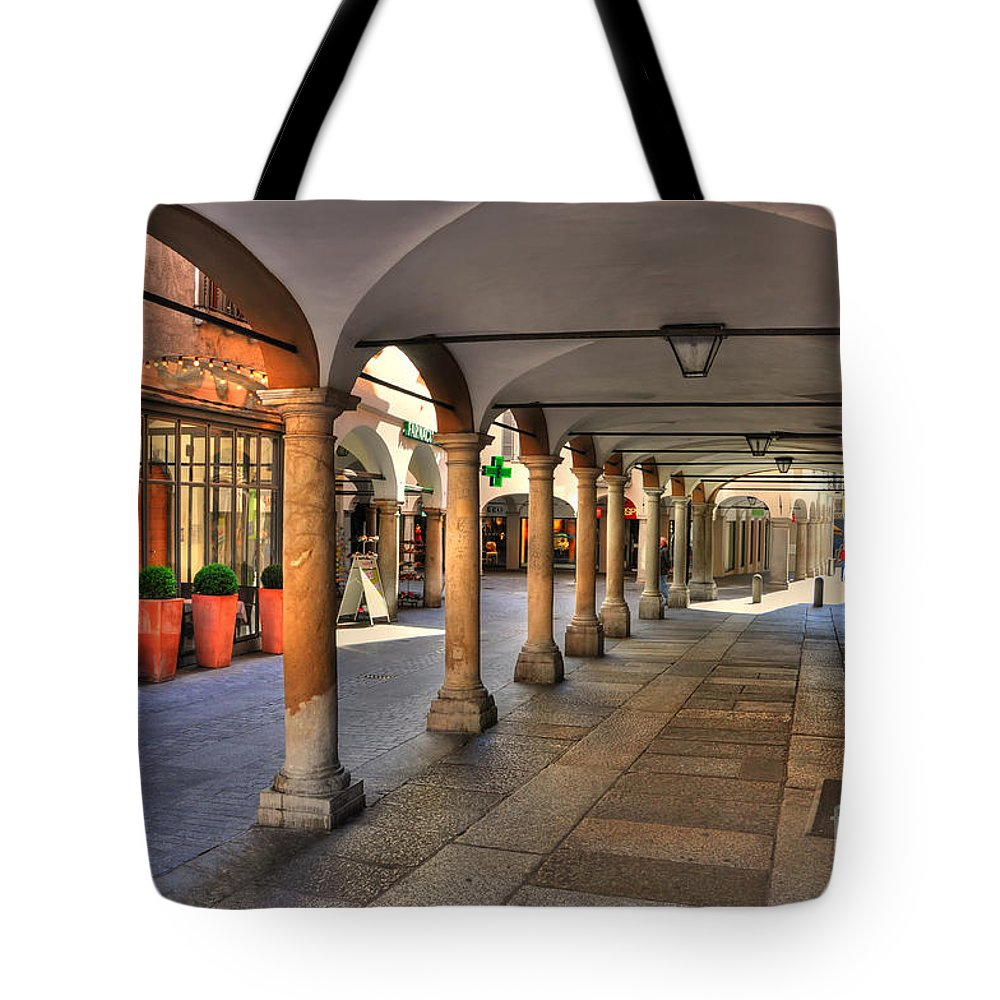 Street Tote Bag featuring the photograph Street With Arches And Columns by Mats Silvan