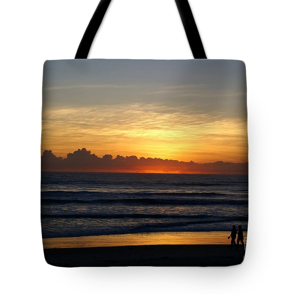 Beach Tote Bag featuring the photograph Strolling The Beach During Sunset by Patricia Twardzik
