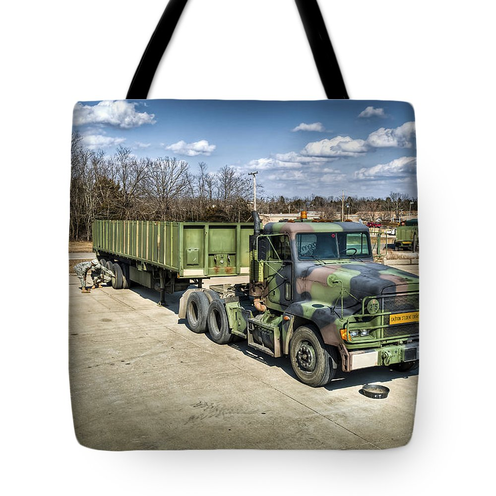 Military Tote Bag featuring the photograph Students Checking The Trailer Of A M872 by Stocktrek Images