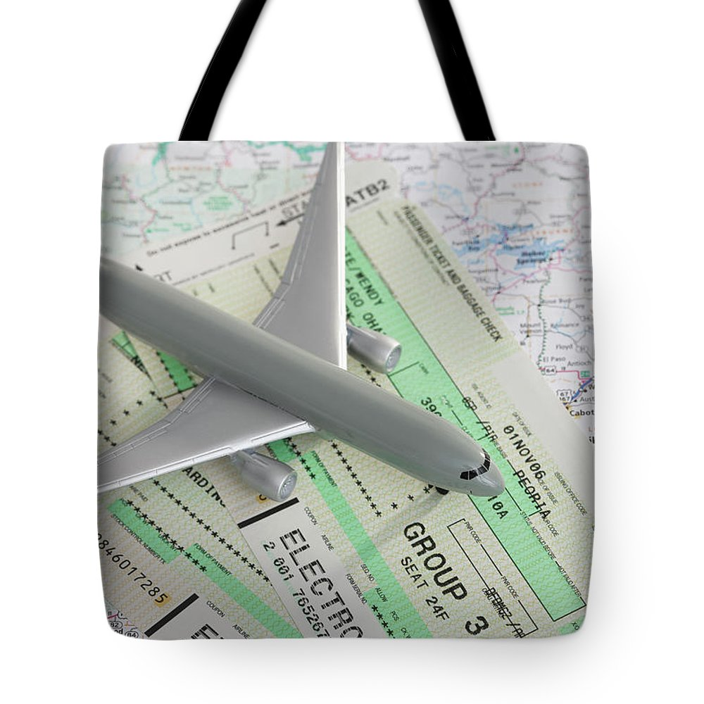 Airplane Tote Bag featuring the photograph Studio Shot Of Toy Airplane With by Vstock Llc
