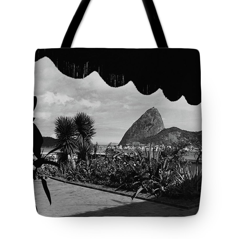 Exterior Tote Bag featuring the photograph Sugarloaf Mountain Seen From The Patio At Carlos by Luis Lemus