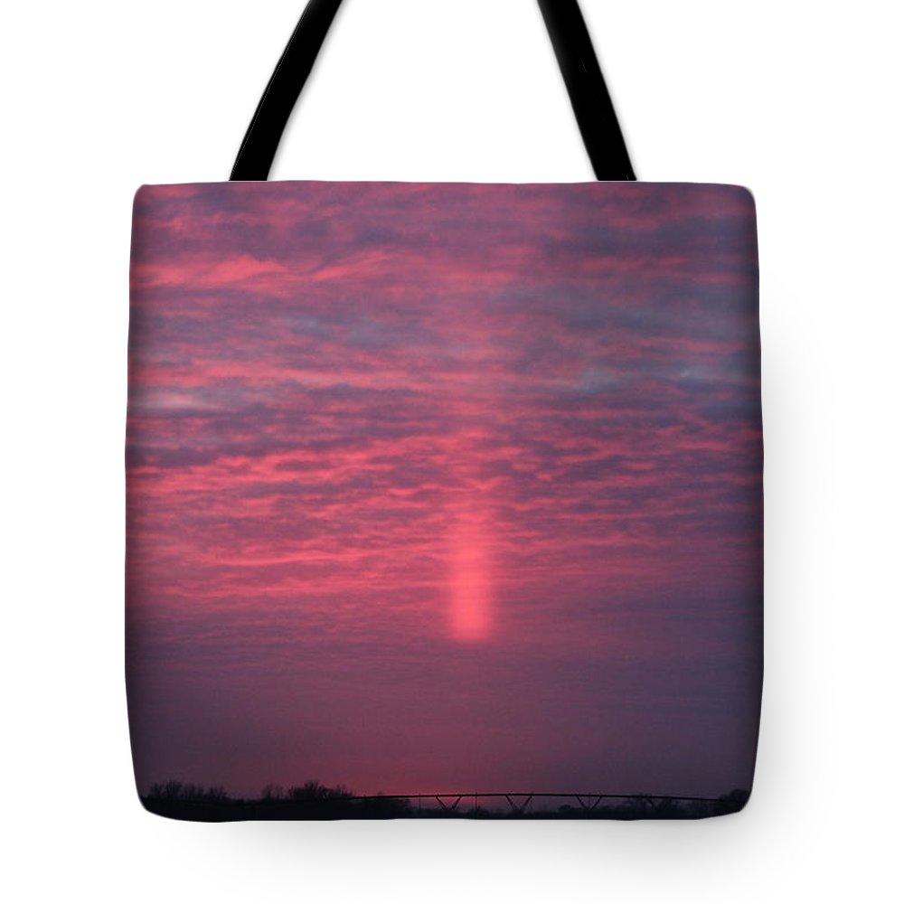 Sunsets Tote Bag featuring the photograph Sun Pillar Horizontal by Wayne Williams