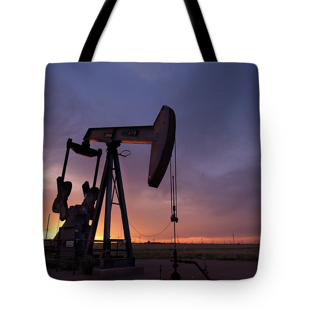 Oil Tote Bag featuring the photograph Sun Setting On Big Money by Melany Sarafis