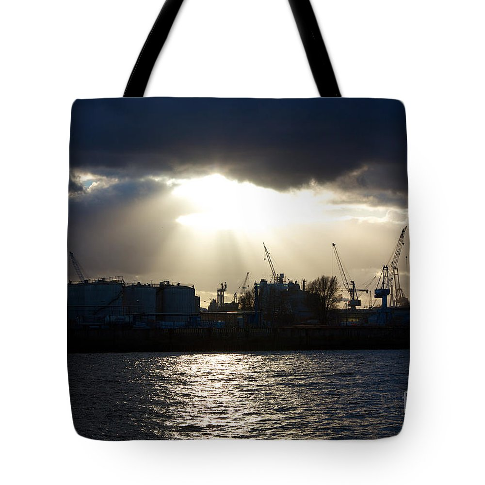 Afternoon Tote Bag featuring the photograph Sun Shining Through Clouds by Jannis Werner