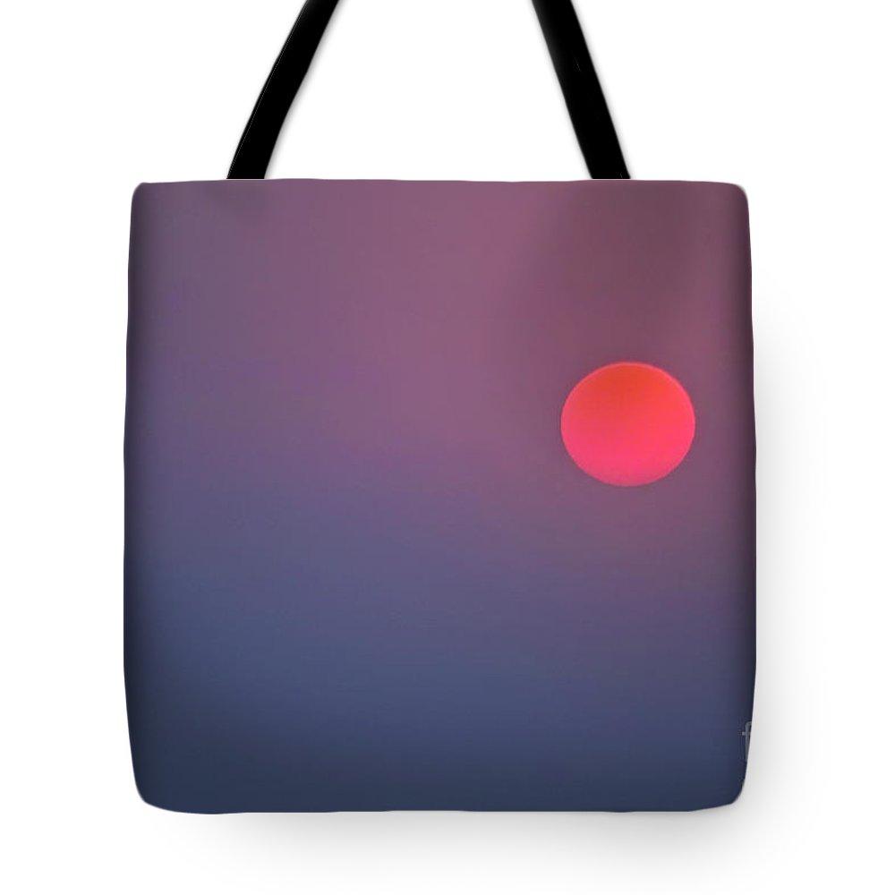 Sun Tote Bag featuring the photograph Sundown by Heiko Koehrer-Wagner