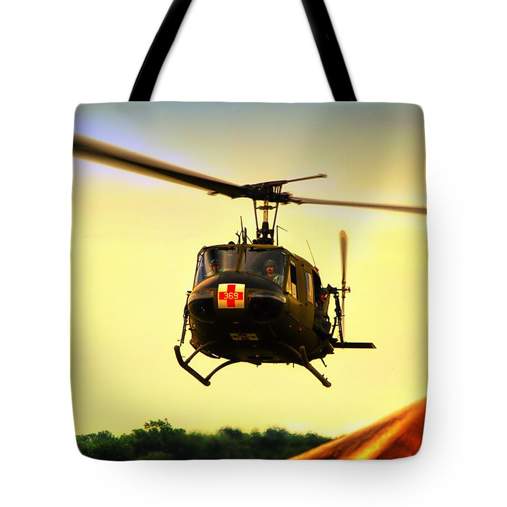 Dust Off Tote Bag featuring the photograph Sundown On The Medevac by Thomas Woolworth