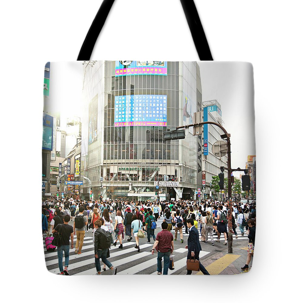 Crowd Tote Bag featuring the photograph Sunny Day In Shibuya by Xavierarnau