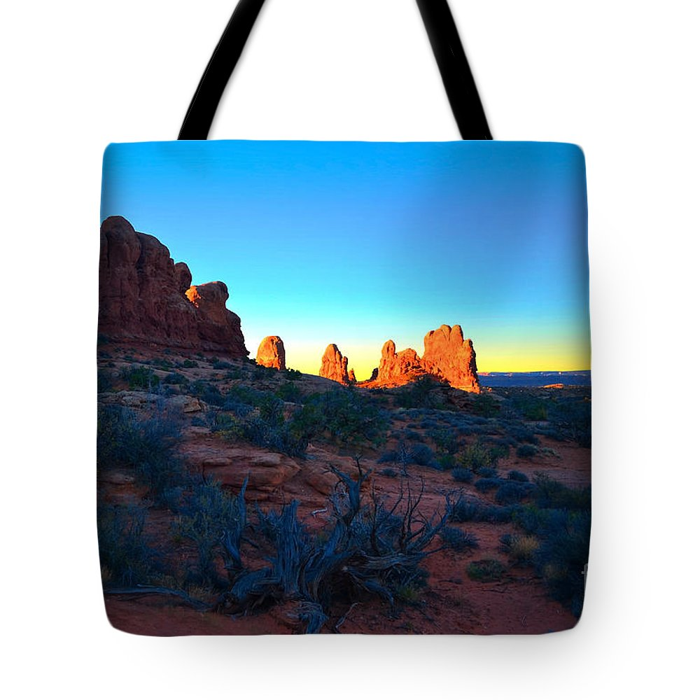 Sunrise Tote Bag featuring the photograph Sunrise At Arches National Park by Tara Turner