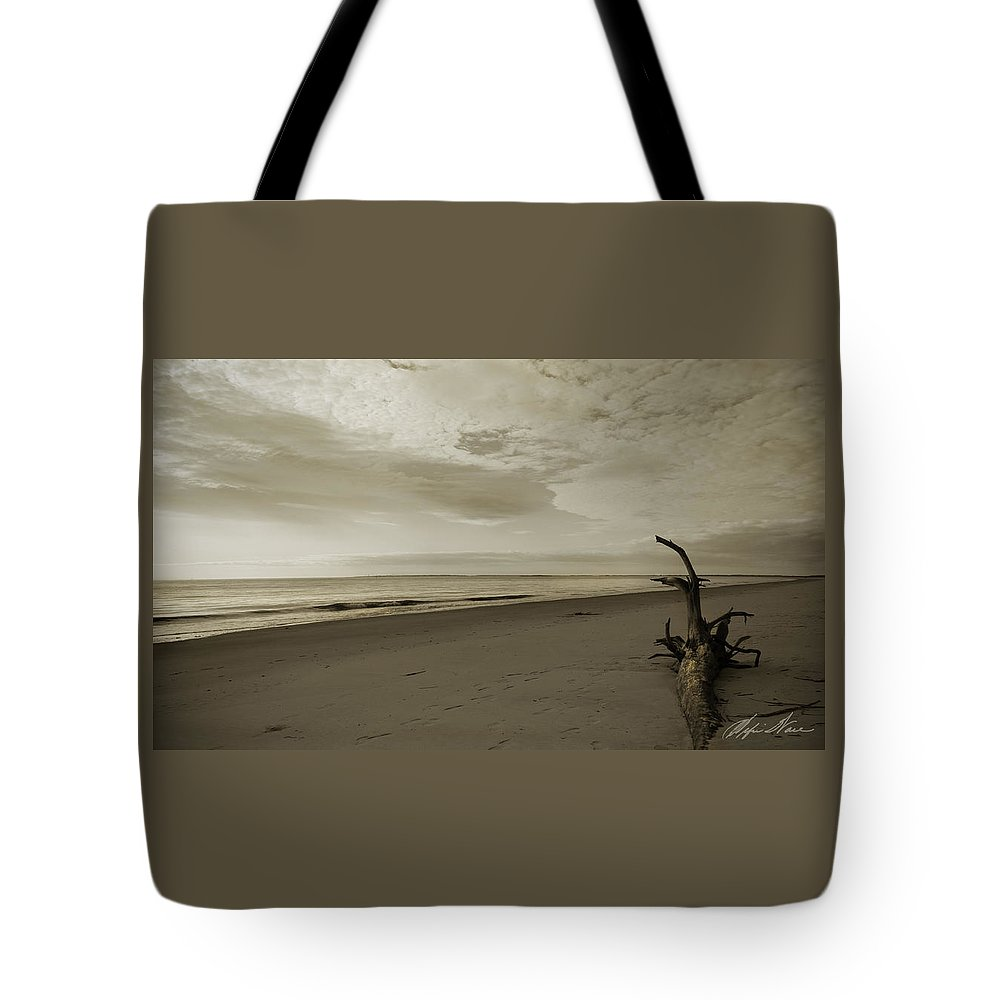 Barrier Island Tote Bag featuring the photograph Sunrise On Driftwood by Alfie Wace