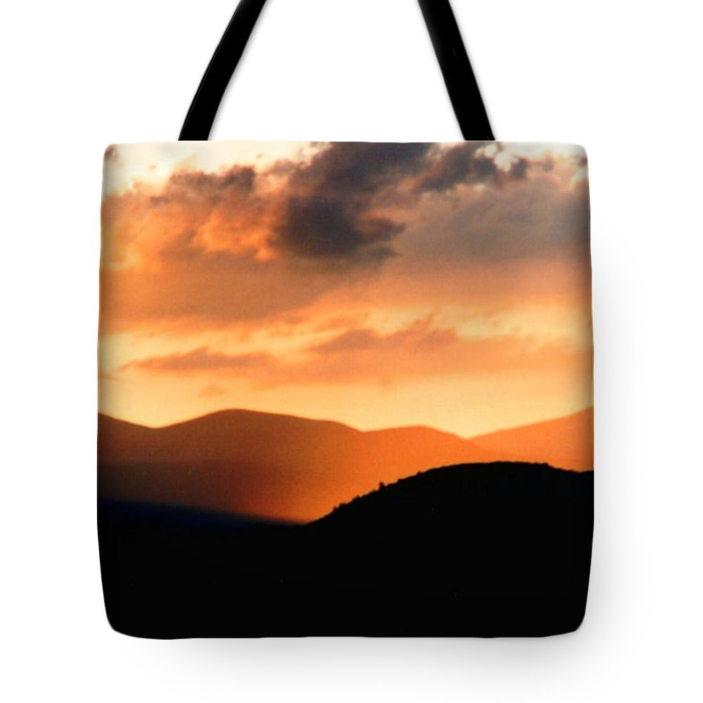 Sunrise Tote Bag featuring the photograph Sunrise On The Hills by Jason Micheal