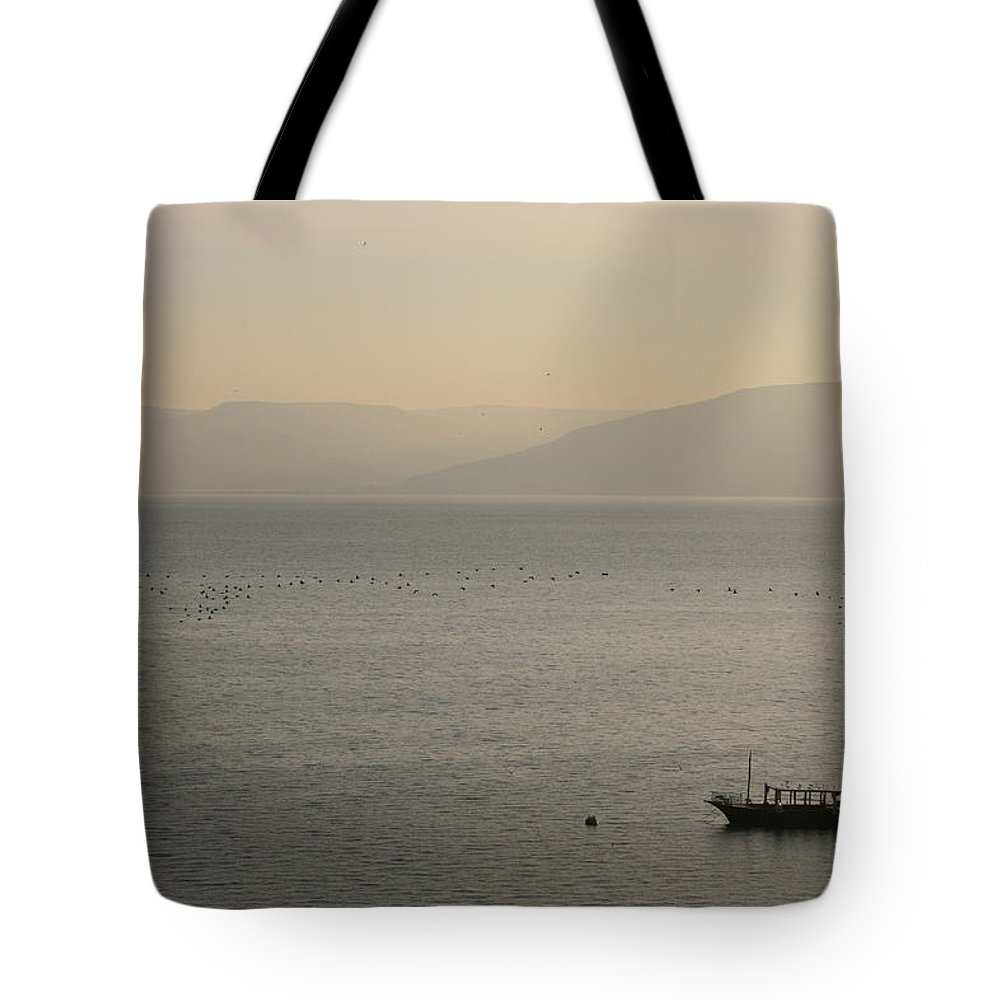 Sea Of Galilee Tote Bag featuring the photograph Sunrise On The Sea Of Galilee by Betty-Anne McDonald