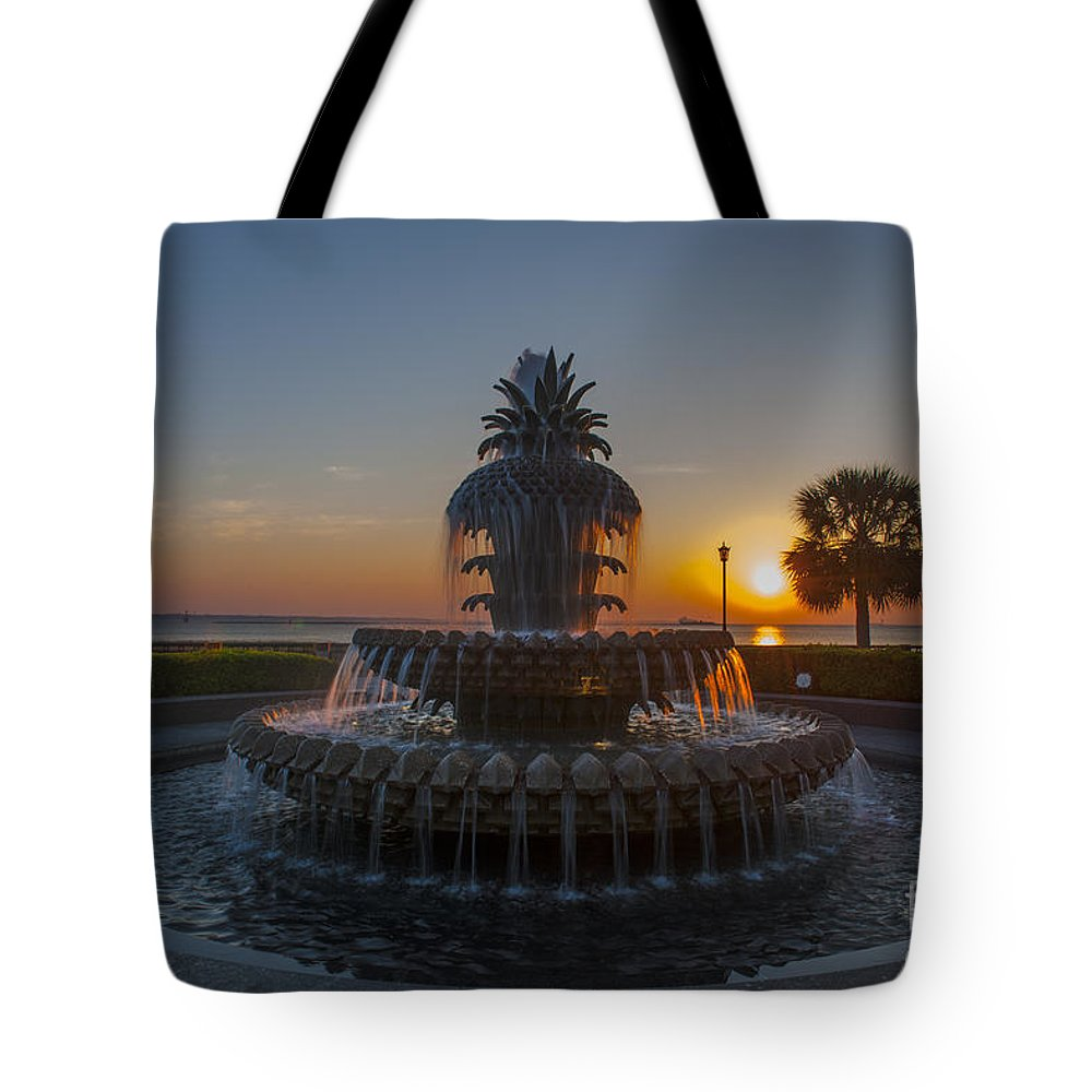 Pineapple Fountain At Waterfront Park In Downtown Charleston Sc Tote Bag featuring the photograph Sunrise Over Downtown Charleston by Dale Powell