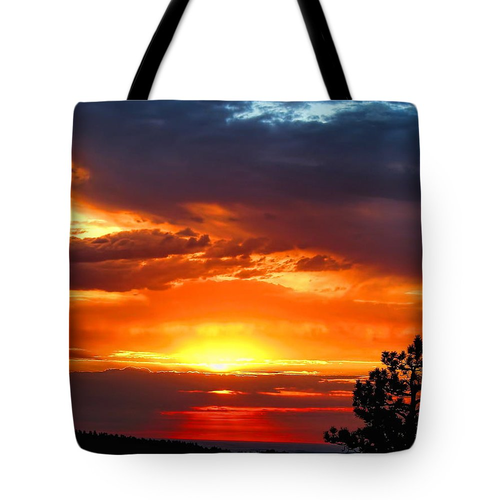 Sunrise Tote Bag featuring the photograph Sunrise Over Keystone by Dale Kauzlaric