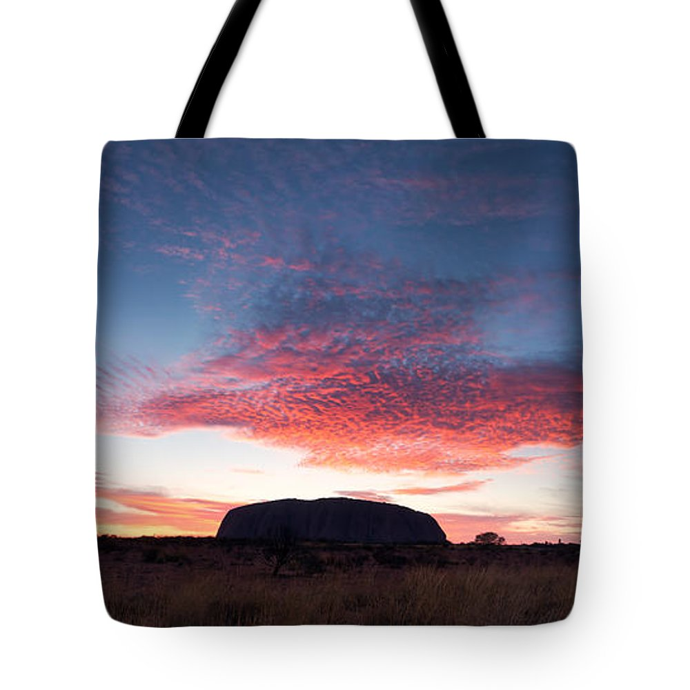 Uluru Tote Bag featuring the photograph Sunrise Over Uluru by Matteo Colombo
