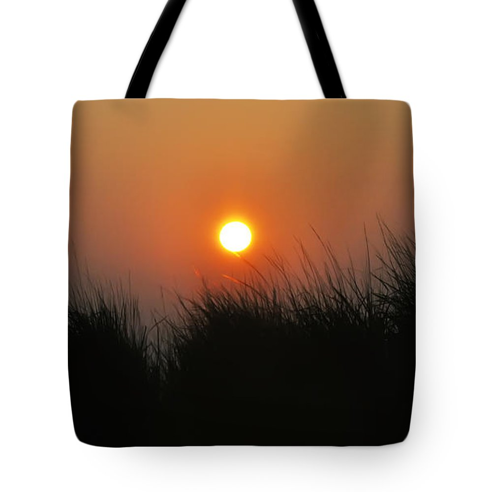 Sunrise Tote Bag featuring the photograph Sunrise Through The Tall Grass by Bill Cannon