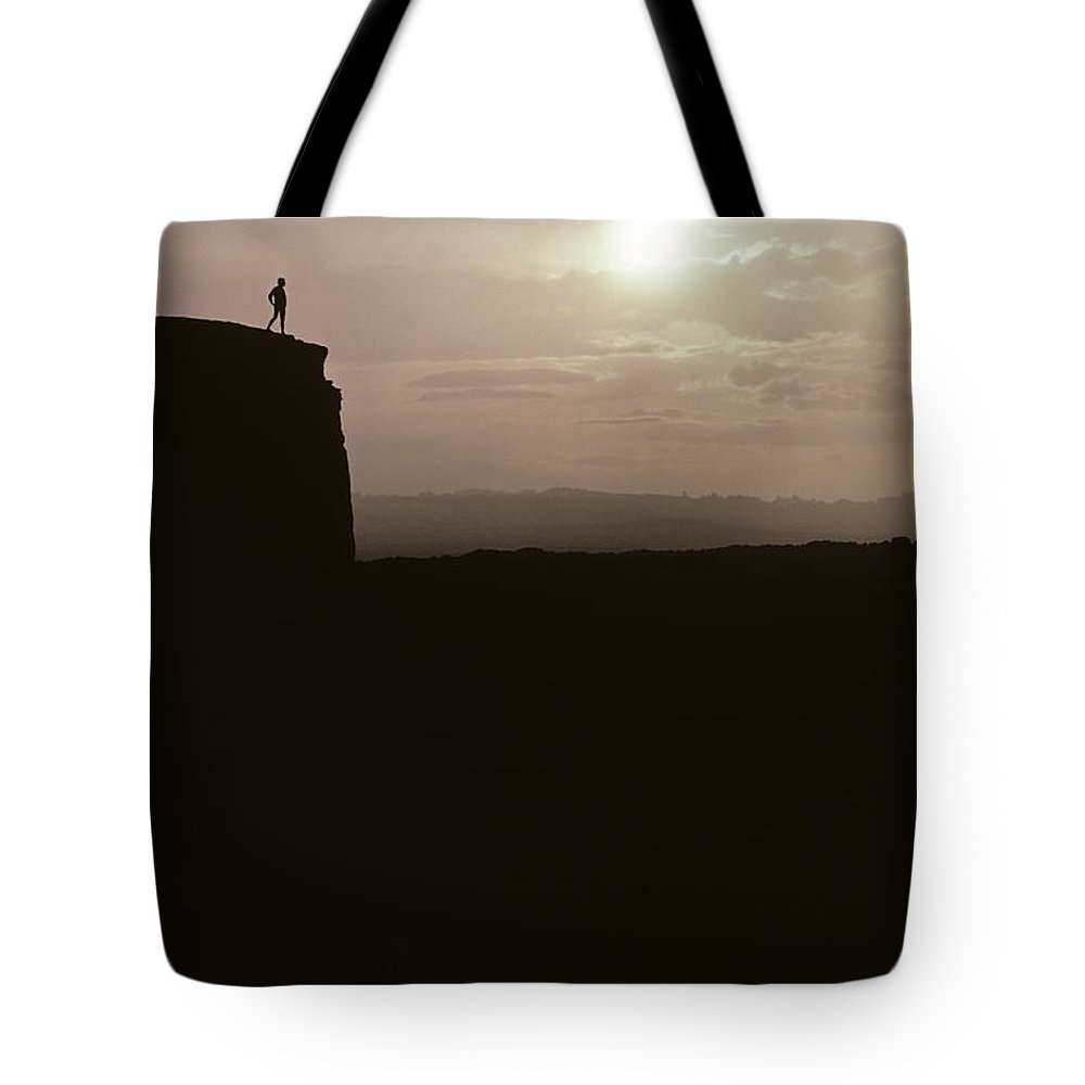 Landscape Tote Bag featuring the photograph Sunset Arches National Park With Silhouetted Man On Ridge With S by Jim Corwin