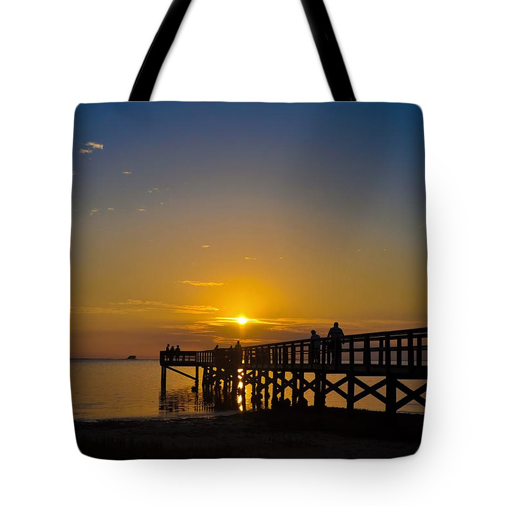 Sunset Tote Bag featuring the photograph Sunset At Crystal Beach Pier by Bill Cannon