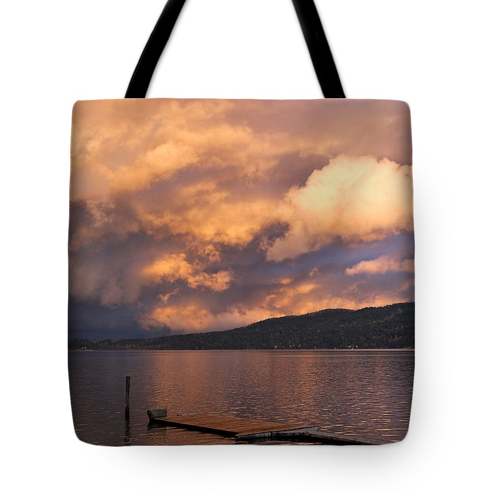 Sunset Tote Bag featuring the photograph Sunset At The Dock by Louise Heusinkveld