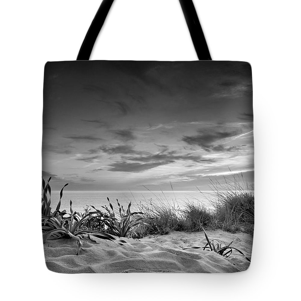 Black And White Tote Bag featuring the photograph Sunset At The Mediterranean Sea by Guido Montanes Castillo