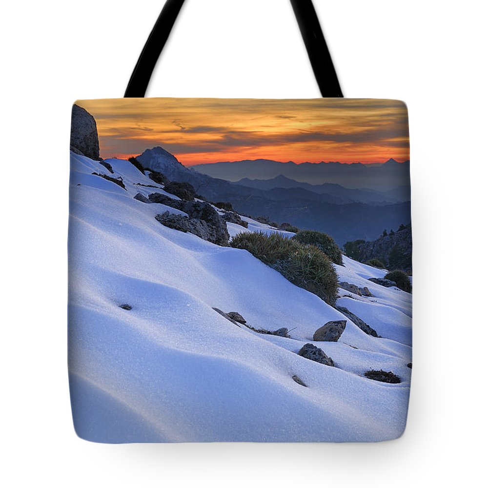 Sunset Tote Bag featuring the photograph Sunset Light On The Snow by Guido Montanes Castillo