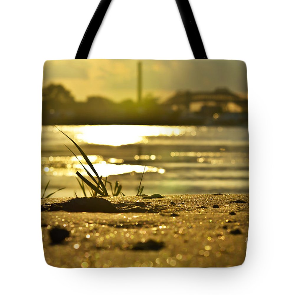 Sunset Tote Bag featuring the photograph Sunset On A Sandy Beach by PatriZio M Busnel