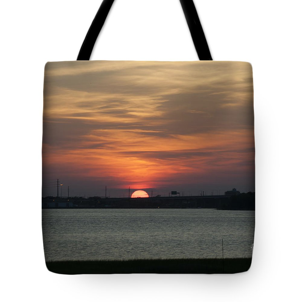 Sunset Tote Bag featuring the photograph Sunset Over Charleston Harbor by Dale Powell