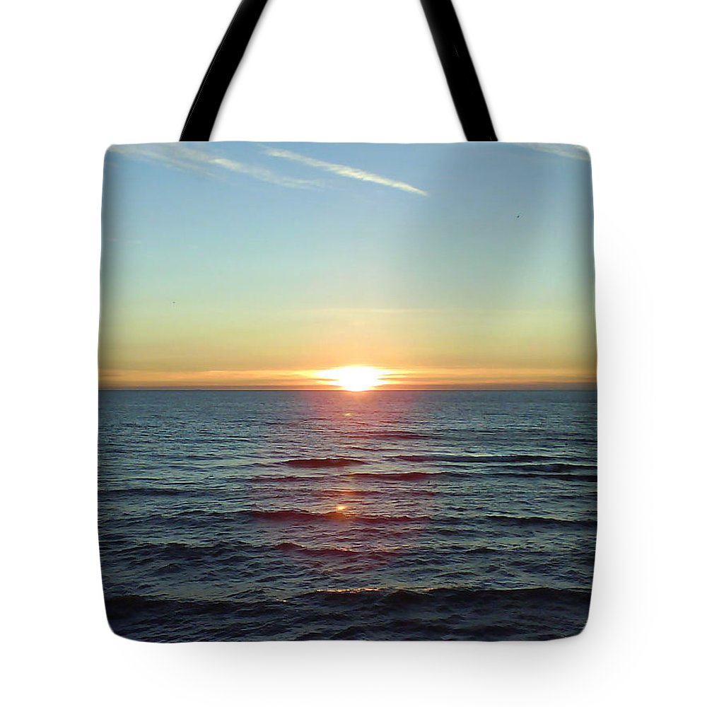 Sunset Over Sea Tote Bag featuring the photograph Sunset Over Sea by Gordon Auld