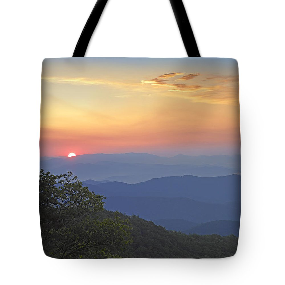 Blue Ridge Parkway Tote Bag featuring the photograph Sunset Over The Pisgah National Forest by Tim Fitzharris