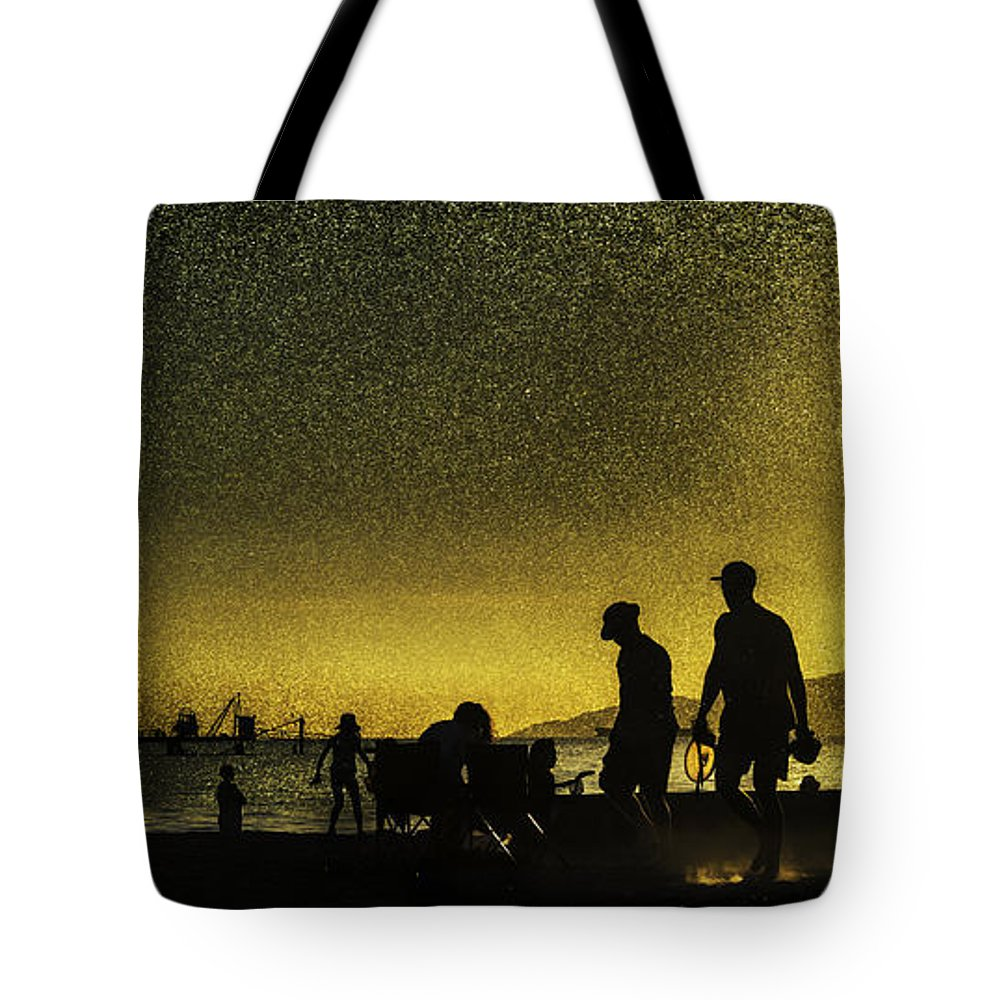 Back Lit Tote Bag featuring the photograph Sunset Silhouette Of People At The Beach by Peter v Quenter