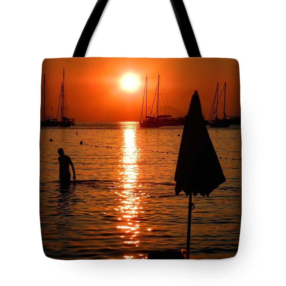 Asia Tote Bag featuring the photograph Sunset by Ulisse Bart