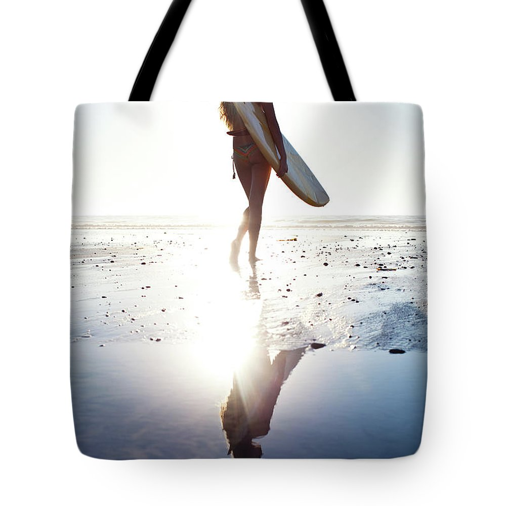 Youth Culture Tote Bag featuring the photograph Surfer Girl by Ianmcdonnell