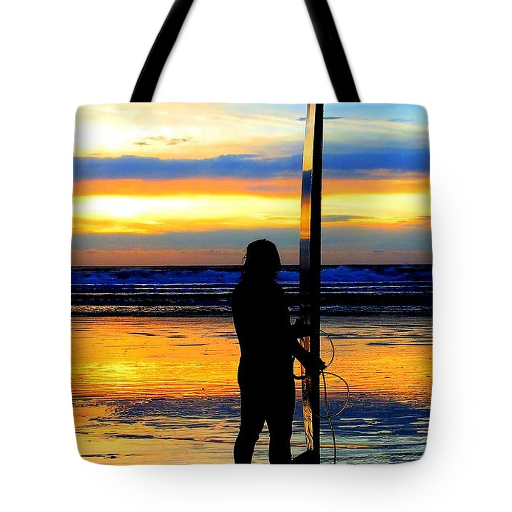 Surfer Tote Bag featuring the photograph Surfer Sunset by Douglas J Fisher