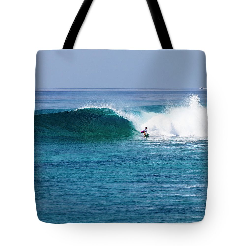 Recreational Pursuit Tote Bag featuring the photograph Surfer Surfing A Wave by Subman