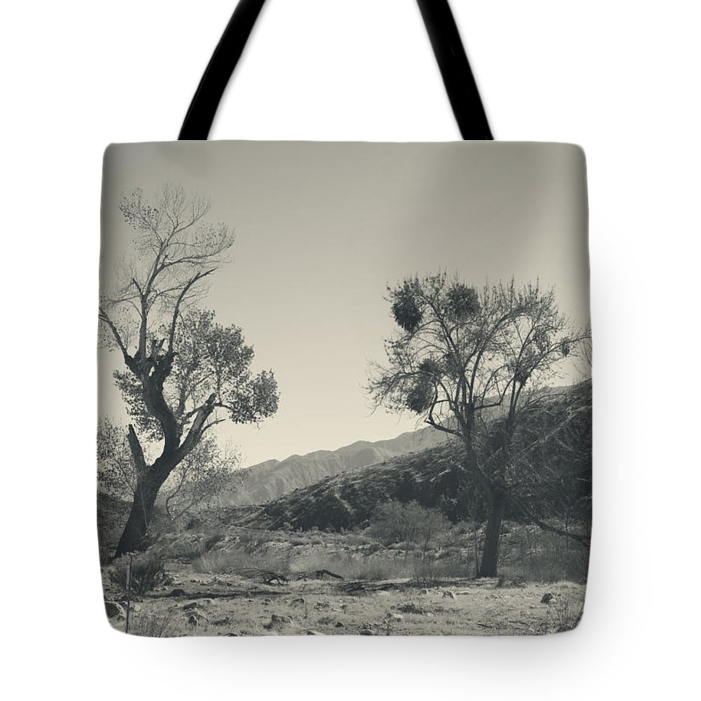 Whitewater Preserve Tote Bag featuring the photograph Suvival Can Be Tough by Laurie Search