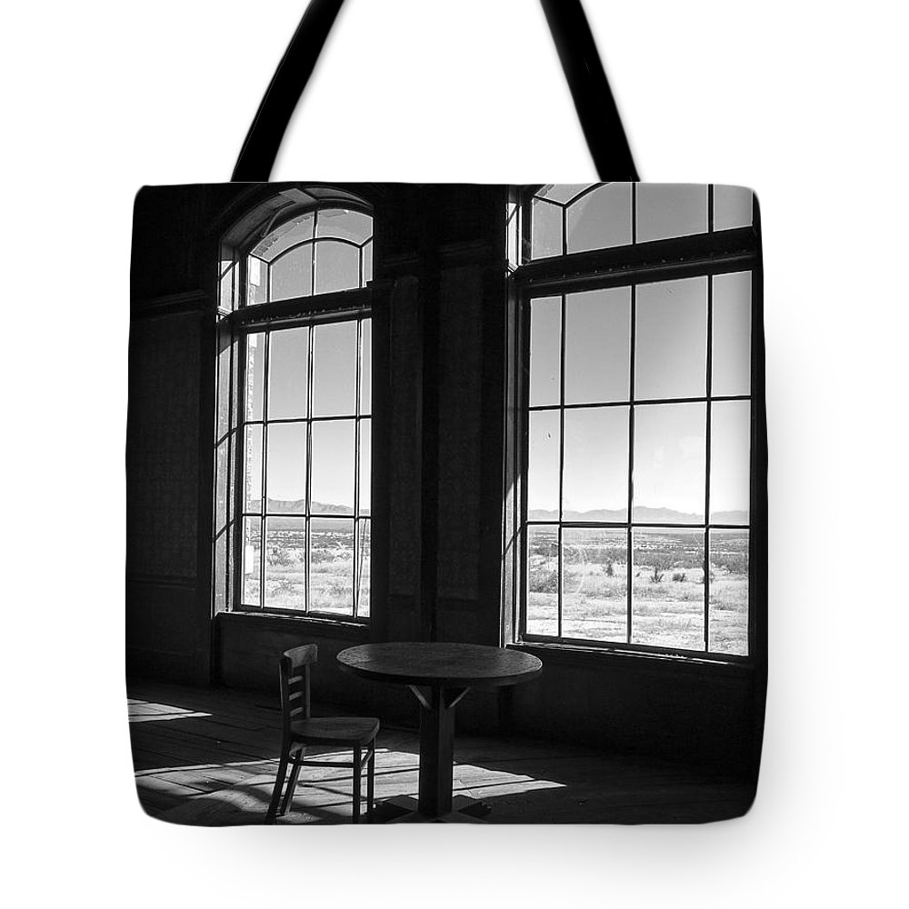 Lucinda Walter Tote Bag featuring the photograph Table And Chair And The Windows by Lucinda Walter