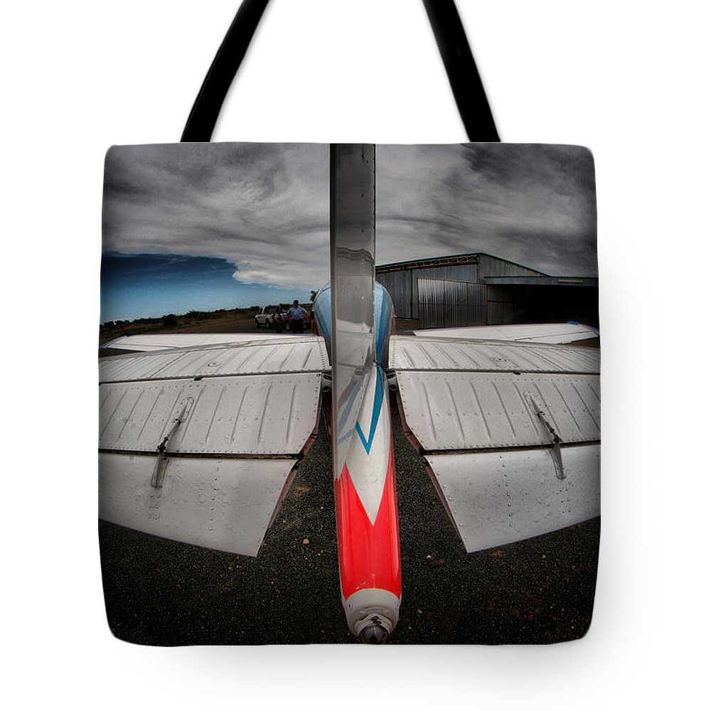 Aviation Tote Bag featuring the photograph Tail Clouds by Paul Job