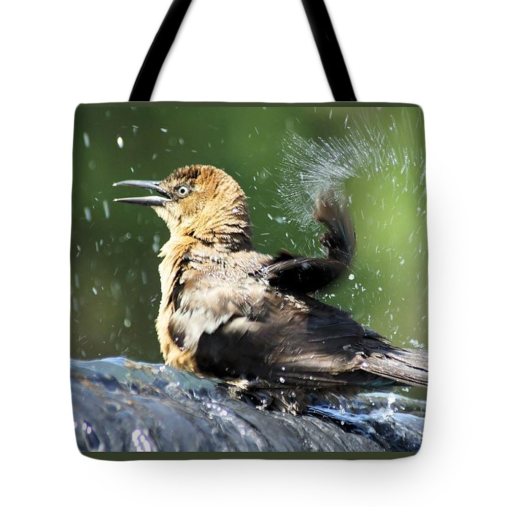 Bird Tote Bag featuring the photograph Taking A Bath. by Evelyn Hill