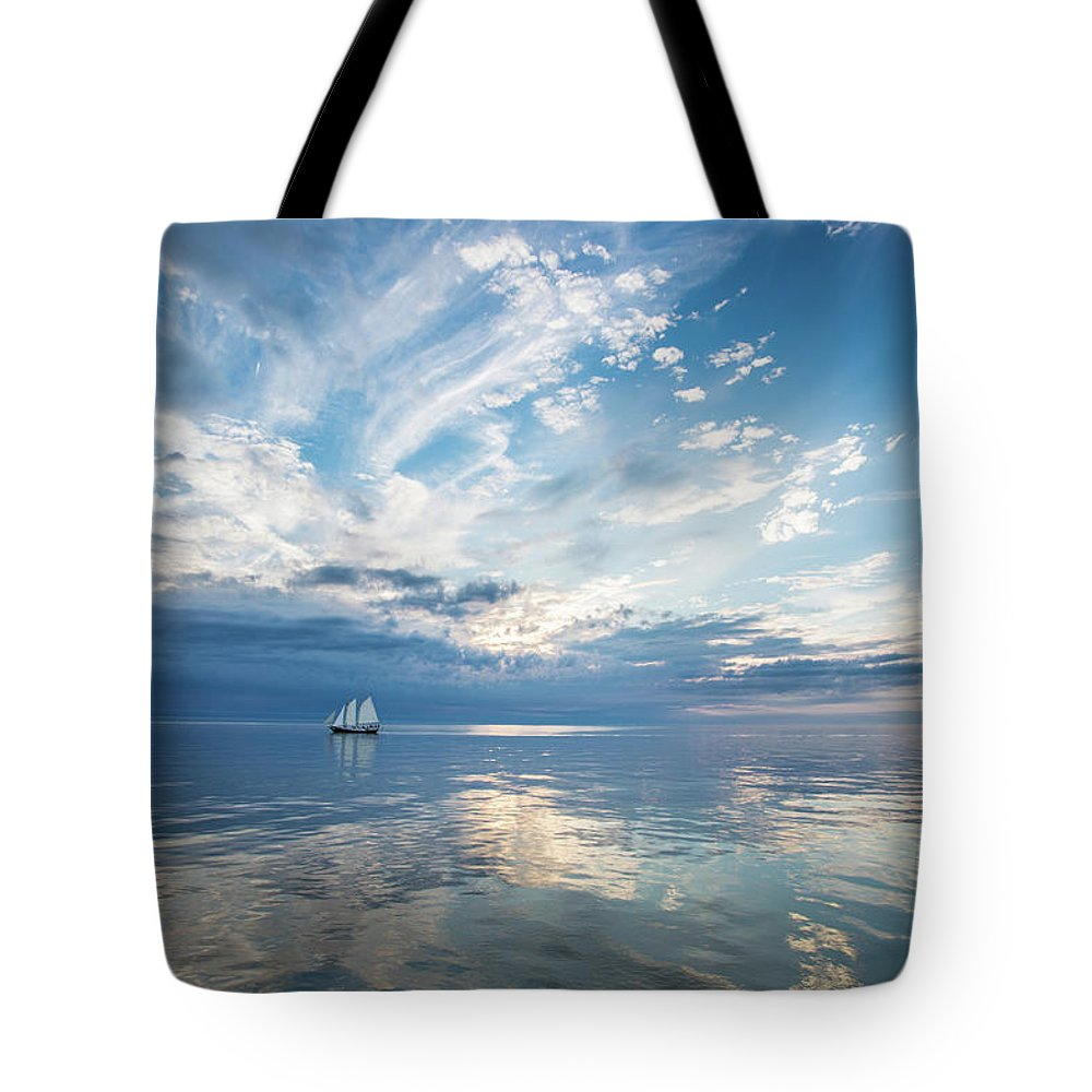 Tranquility Tote Bag featuring the photograph Tall Ship On The Big Lake by Rudy Malmquist