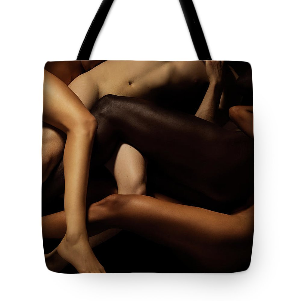 Young Men Tote Bag featuring the photograph Tangled Human Bodies Of Different Skin by Jonathan Knowles