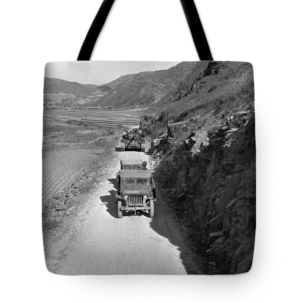War Tote Bag featuring the photograph Tank-led Patrol Of Leathernecks Hunt by Stocktrek Images