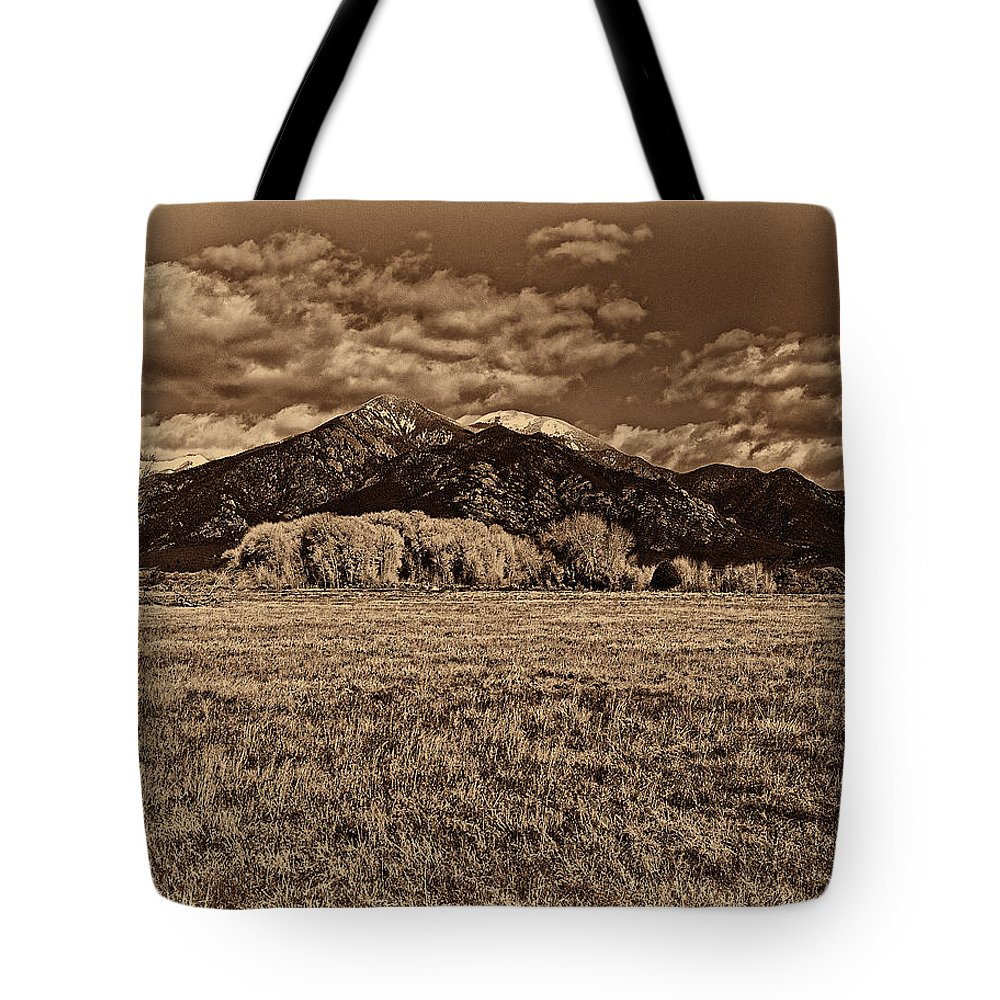 Taos Tote Bag featuring the digital art Taos Mountain In Platinum by Charles Muhle