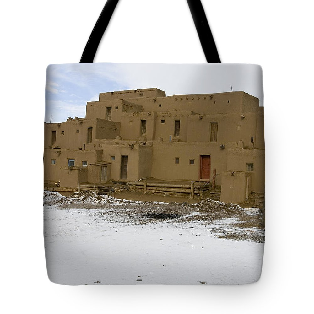 Taos Tote Bag featuring the photograph Taos Pueblo With Snow by Jason O Watson