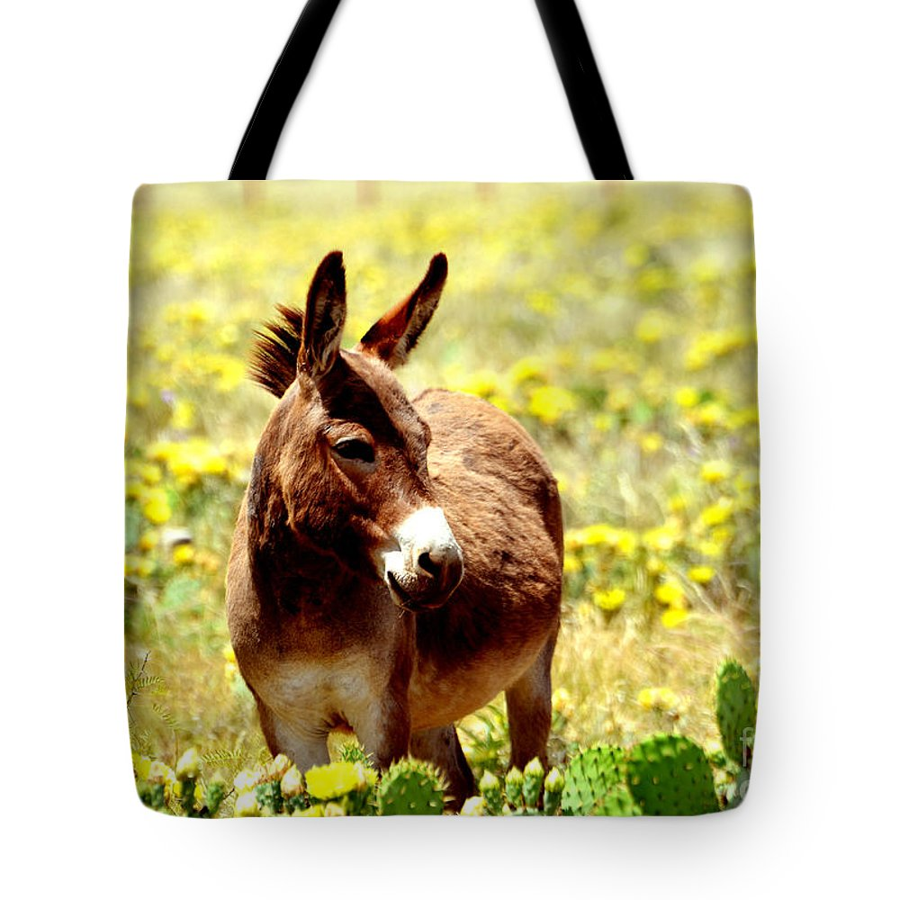Texas Tote Bag featuring the photograph Texas Donkey In Yellow Cacti by Linda Cox